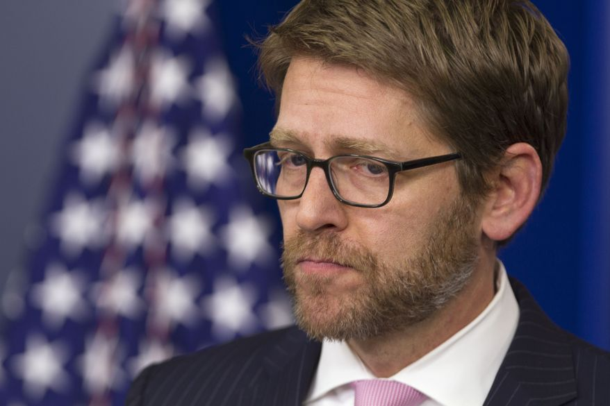 **FILE** White House press secretary Jay Carney listens to a question during his daily news briefing at the White House in Washington, Wednesday, Jan. 8, 2014, where he discussed topics including former Defense Secretary Robert Gates' book and press access at the White House. (Associated Press)