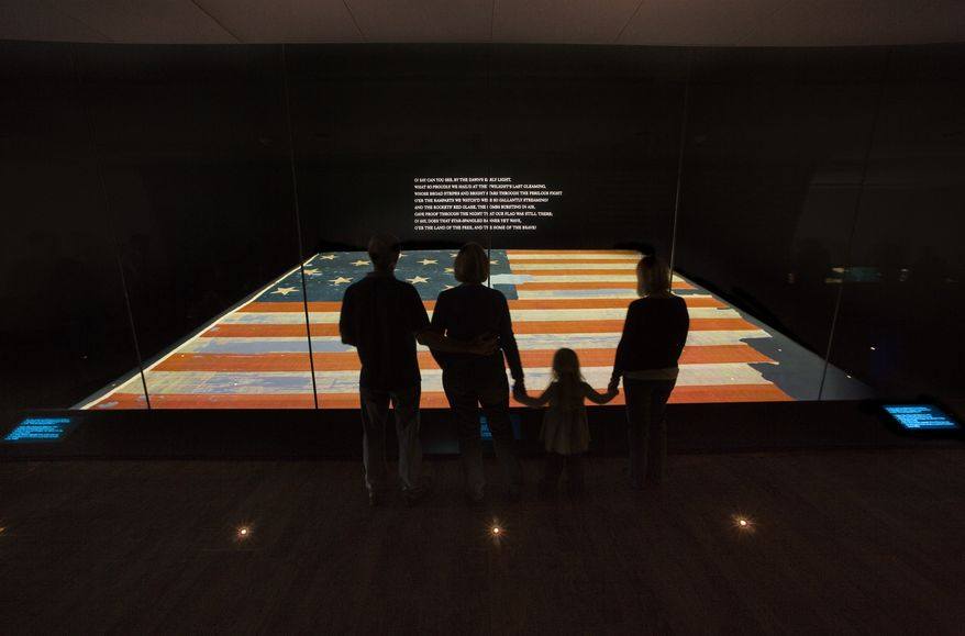 ** FILE ** This handout photo provided by the Smithsonian Institution, taken in November 2008, shows a family viewing the Star Spangled Banner at the Smithsonian's National Museum of American History in Washington. (AP Photo/Hugh Talman, Smithsonian Institution)