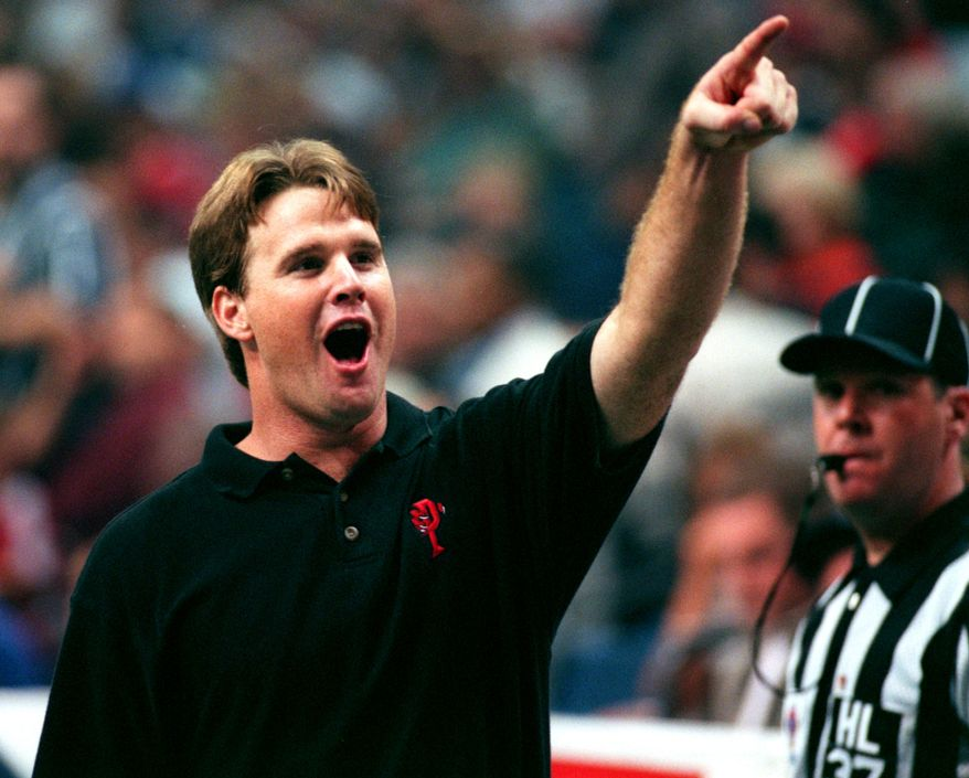 **FILE** Orlando's head coach and former Storm quarterback Jay Gruden cheers while pointing up to the Orlando fan section during the closing minutes of an Orlando victory over the Tampa Bay Storm during the Arena Bowl XII at the Ice Palace in Tampa on Sunday, August 23, 1998. (Photo By:Dirk Shadd/Tampa Bay Times)