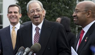 ** FILE ** Rep. Chaka Fattah, D-Pa., center, flanked by Los Angeles Mayor Eric Garcetti, left, and Philadelphia Mayor Michael Nutter, right, speaks outside the White House in Washington, Thursday, Jan. 9, 2014, after an event hosted by President Barack Obama about the Promise Zones Initiative. (AP Photo/Carolyn Kaster)