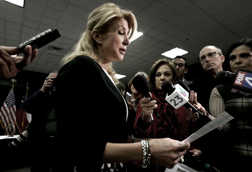 Texas Sen. Wendy Davis reads her education proposals to reporters after a meeting in Arlington, Texas, Thursday, Jan. 9, 2014.  Davis, the presumptive Democratic nominee for Texas governor, unveiled education proposals at the North Texas roundtable meeting. (AP Photo/LM Otero)