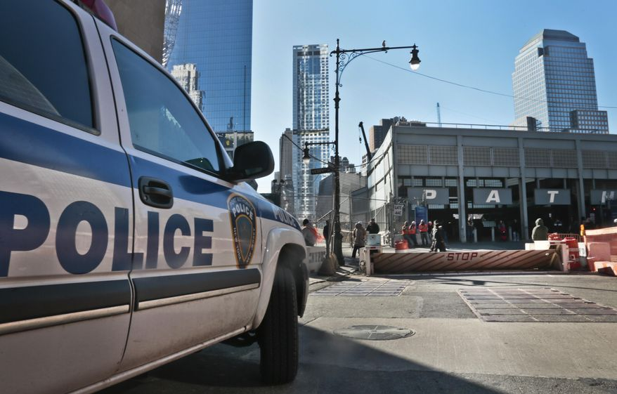 A police vehicle sits near a mechanical barricade blocking a street near the World Trade center site, on Thursday, Jan. 9, 2014 in New York. Area residents living in the the shadow of the World Trade center have filed a lawsuit against city plans to build a security perimeter around her neighborhood, they say would permanently restrict street access, create congestion and health hazards, among their concerns.  (AP Photo/Bebeto Matthews)