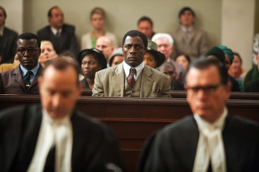 """This image released by The Weinstein Company shows, Idris Elba as Nelson Mandela, center in the film, """"Mandela: Long Walk to Freedom."""" The film was nominated for an Image Award for best motion picture on Thursday, Jan. 9, 2014.  The 45th NAACP Image Awards will be held on Feb. 22. (AP Photo/The Weinstein Company, Keith Bernstein)"""