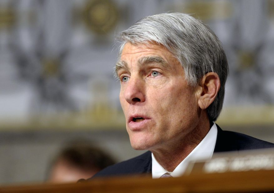 FILE - In this Thursday, Jan. 31, 2013 file photo, Sen. Mark Udall, D-Colo., speaks on Capitol Hill in Washington. Republicans say Udall tried to put pressure on state health officials to change the number of people who had their health insurance policies cancelled. (AP Photo/Susan Walsh,File)