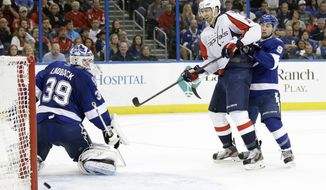 Washington Capitals right wing Eric Fehr (16) scores past Tampa Bay Lightning goalie Anders Lindback (39), of Sweden, during the third period of an NHL hockey game Thursday, Jan. 9, 2014, in Tampa, Fla. Defending for the Lightning is Tyler Johnson (9). The Capitals won 4-3. (AP Photo/Chris O'Meara)
