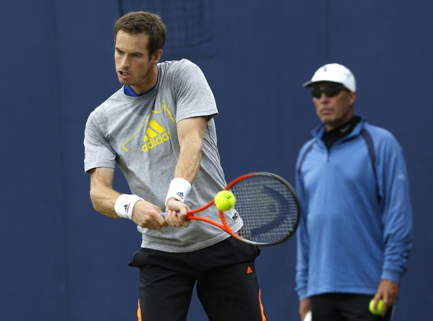 ADVANCE FOR WEEKEND OF JAN. 11-12 - FILE - In this June 11, 2013, file photo, Andy Murray, left, is watched by his coach Ivan Lendl as he plays a return during a training session at the Queen's Club grass court championships in London. Novak Djokovic and Roger Federer witnessed Murray's breakthrough successes after hiring Lendl as coach, so they have also turned to some past Grand Slam champions for help in 2014. (AP Photo/Kirsty Wigglesworth, File)