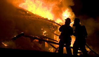 Firefighters could do little to save a home along State Road in Dornsife, Pa., early Thursday, Jan. 9, 2014. The home was fully engulfed by flames when they arrived. (Associated Press/The News-Item, Larry Deklinski)