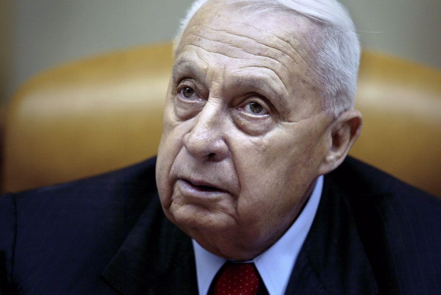 FILE - In this Sunday Jan. 30, 2005 file photo, Israeli Prime Minister Ariel Sharon pauses during the weekly cabinet meeting in his Jerusalem office. The Israeli hospital treating Sharon said Thursday, Jan. 9, 2014 that the former prime minister has deteriorated further and he is now in 'grave' condition. Sharon, who has been comatose since suffering a stroke eight years ago, suffered a downturn in his health last week with a decline in key bodily organs.(AP Photo/Oded Balilty, Pool, File)