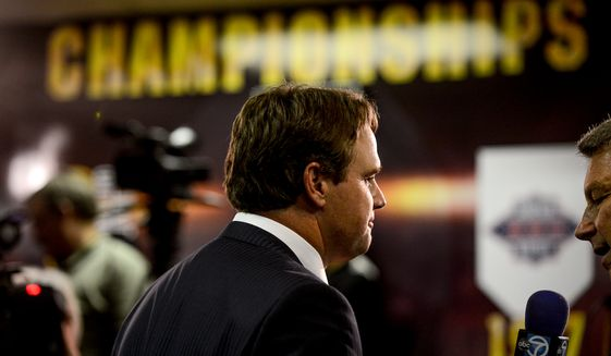 Former Cincinnati Bengals offensive coordinator Jay Gruden is interviewed by a television station after he is announced as the new head coach of the Washington Redskins at a press conference at Redskins Park, Ashburn, Va., Thursday, January 9, 2014. (Andrew Harnik/The Washington Times)