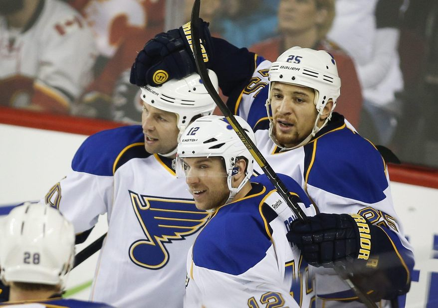 St. Louis Blues' Chris Stewart, right, celebrates his goal with teammates Brenden Morrow, left, and Derek Roy during first-period NHL hockey game action against the Calgary Flames in Calgary, Alberta, Thursday, Jan. 9, 2014. (AP Photo/The Canadian Press, Jeff McIntosh)