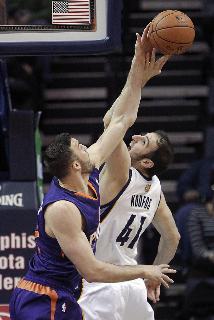Memphis Grizzlies center Kosta Koufos (41) fights for a rebound against Phoenix Suns center Miles Plumlee, left, in the first half of an NBA basketball game, Friday, Jan. 10, 2014, in Memphis, Tenn. (AP Photo/Lance Murphey)