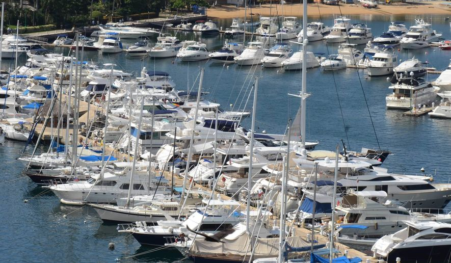 In this Tuesday,  Jan. 7, 2014 file photo, yachts are docked at a marina in the Bay of Acapulco, Mexico. (AP Photo/Bernandino Hernandez)
