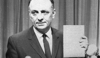 U.S. Surgeon General Luther Terry holds a copy of the 387 page report of the Advisory Committe to the Surgeon General of the Public Health Service on the relationship of smoking to health Jan. 11, 1964.  He spoke at a Washington news conference at which the study was released.  It termed smoking a health hazard calling for corrective action. (AP Photo/hwg)