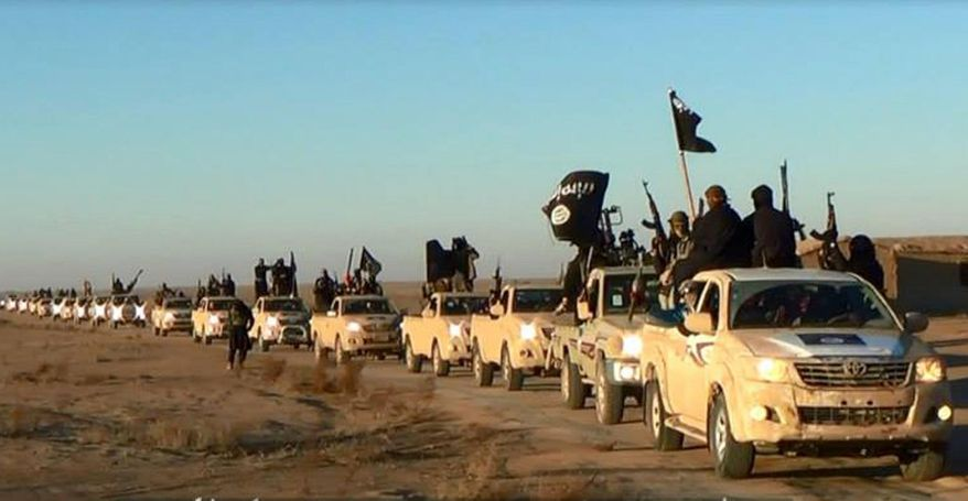 This image posted on a militant website on Tuesday, Jan. 7, 2014, which is consistent with AP reporting, shows a convoy of vehicles and fighters from the al-Qaida linked Islamic State of Iraq and the Levant (ISIL) fighters in Iraq's Anbar Province. With al-Qaida linked fighters and allied tribal gunmen camped on the outskirts, a tentative calm took hold over Fallujah on Friday, Jan. 10, 2014 and residents started to return to the besieged city west of Baghdad. Government forces were stationed nearby as sporadic street fighting breaks out in other cities. The picture painted by residents, officials and international groups suggests that both the militants and government forces are preparing for a long standoff with civilians caught in the middle.(AP Photo via militant website)