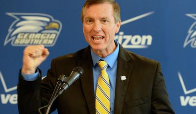 Willie Fritz gestures during a news conference where he was named the new head NCAA college football coach at Georgia Southern University in Statesboro, Ga., Friday, Jan. 10, 2014.  (AP Photo/The Morning News, Richard Burkhart)  THE EXAMINER.COM OUT; SFEXAMINER.COM OUT; WASHINGTONEXAMINER.COM OUT