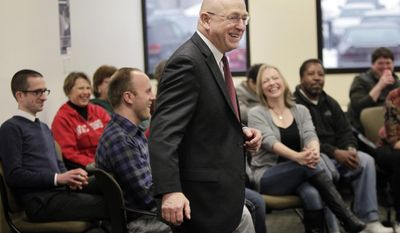 Ray W. Cross, the newly appointed president of the University of Wisconsin System, talks with his administration employees during a meet and greet event in Madison, Wis., Friday, Jan. 10, 2014. (AP Photo/Wisconsin State Journal, M.P. King)
