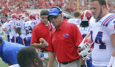 This Aug. 31, 2013 photo provided by Louisiana Tech University shows Louisiana Tech defensive coordinator Kim Dameron on the sidelines during an NCAA football game against North Carolina State in Raleigh, N.C. On Friday, Jan. 10, 2014, Eastern Illinois University announced that Dameron has been hired as its new head football coach, replacing Dino Babers who became head coach at Bowling Green. Dameron has never been a head coach. He spent last season at Louisiana Tech after working as Cornell's defensive coordinator in 2012. (AP Photo/Courtesy of the Louisiana Tech University, Tom Morris)