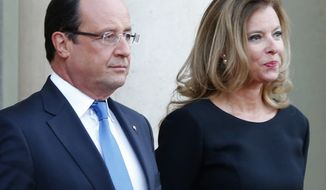** FILE ** In this Sept. 3, 2013, file photo, French President Francois Hollande and his companion Valerie Trierweiler wait for German President Joachim Gauckand, at the  Elysee Palace, in Paris. (AP Photo/Jacques Brinon, File)