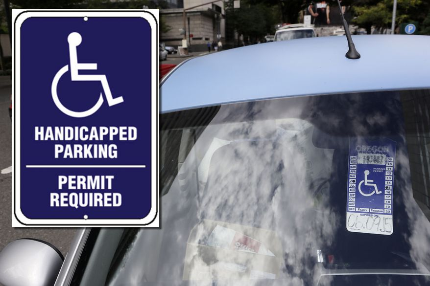 PHOTO ILLUSTRATION  A handicapped parking tag hangs from the rearview mirror of a car parked.