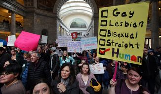 Supporters of gay marriage fill the rotunda as they gathered to rally at the Utah State Capitol Friday Jan. 10. 2014, and  deliver a petition with over 58,000 signatures in support of gay marriage to Utah Governor Gary Herbert.  (AP Photo/Steve C. Wilson)