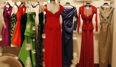 KATIE FALKENBERG/THE WASHINGTON TIMES FASHION FRENZY: Neiman Marcus has an array of gowns ready for the inaugural balls. Another retailer capitalizing on the fashion epidemic is DressRegistry.com, which is helping women avoid the embarrassment of wearing the same gown as someone else.