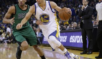 Golden State Warriors' Stephen Curry (30) dribbles past Boston Celtics' Avery Bradley during the second half of an NBA basketball game on Friday, Jan. 10, 2014, in Oakland, Calif.  Golden State won 99-97. (AP Photo/Marcio Jose Sanchez)