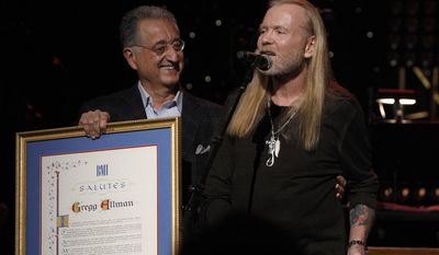 Gregg Allman received an award from Del Bryant, President of BMI during the show at All My Friends: Celebrating The Songs and Voice of Gregg Allman on Friday, Jan. 10, 2014 in Atlanta, Ga. (Photo by Dan Harr/Invision/AP)