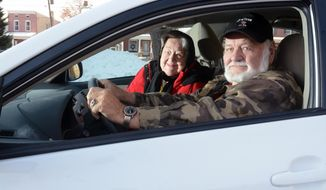 ADVANCE FOR WEEKEND EDITIONS JAN. 11-12 - In this Dec. 19, 2013 photo companions Marilyn Quinter, left, and Bill Boyer pose for a photo in a car in Tilden, Pa. They live together and drove here together. Pennsylvania already has numerous programs and requirements to help ensure seniors are driving safely, such as requiring physicians to report any person they diagnose with medical conditions that could impair their ability to drive.  (AP Photo/Reading Eagle, Ryan McFadden)