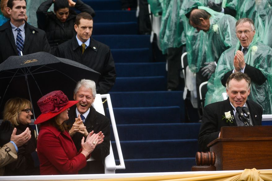 Former U.S. President Bill Clinton and Hilary Clinton, left, applaud as newly sworn in Virginia Gov. Terry McAuliffe, right, prepares to give a speech after being becoming the 72nd Governor of the Commonwealth of Virginia in front of the Virginia State Capitol, Richmond, Va., Saturday, January 11, 2014. (Andrew Harnik/The Washington Times)