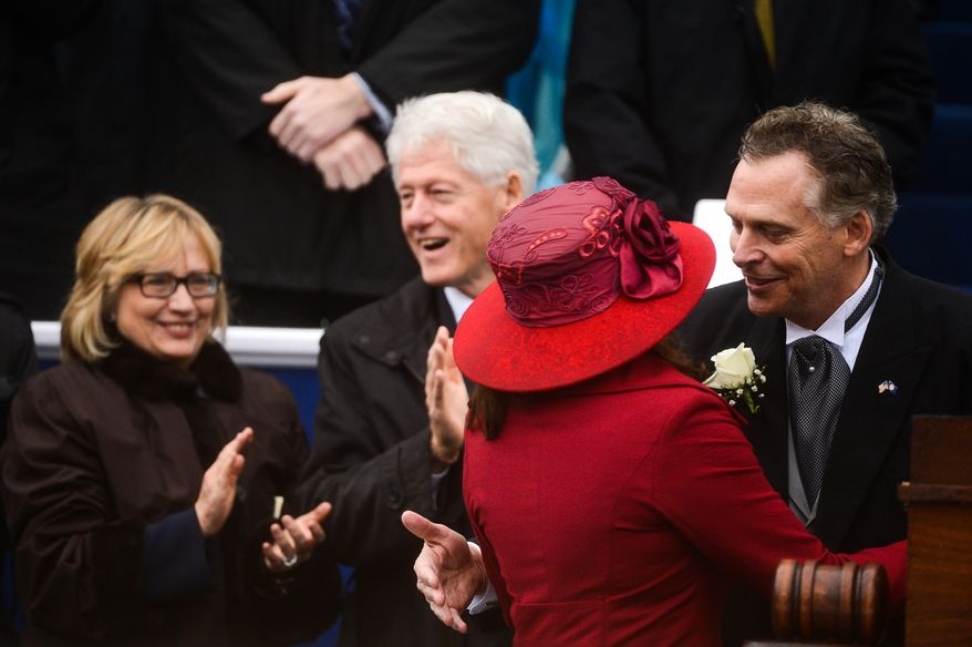 Former U.S. President Bill Clinton and Hilary Clinton applaud as newly sworn in Virginia Gov. Terry McAuliffe, right, kisses his wife, Dorothy, second from right, after being becoming the 72nd Governor of the Commonwealth of Virginia in front of the Virginia State Capitol, Richmond, Va., Saturday, January 11, 2014. (Andrew Harnik/The Washington Times)