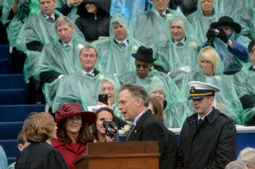 McAuliffe, center, is sworn in as the 72nd Governor of the Commonwealth of Virginia on a very rainy day in front of the Virginia State Capitol, Richmond, Va., Saturday, January 11, 2014. (Andrew Harnik/The Washington Times)
