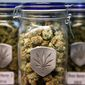 Different strains of pot are displayed for sale at Medicine Man marijuana dispensary in Denver, Friday Dec. 27, 2013. (AP Photo/Brennan Linsley)