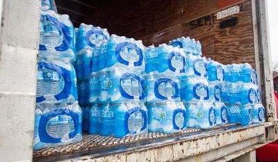 The West Virginia National Guard was sent to distribute bottled water across areas of Kanawha County (W.Va.) Saturday Jan. 11, 2014, as residents bought up stock at local supermarkets following the chemical spill on Thursday, Jan. 9, 2014. (AP Photo Michael Switzer)