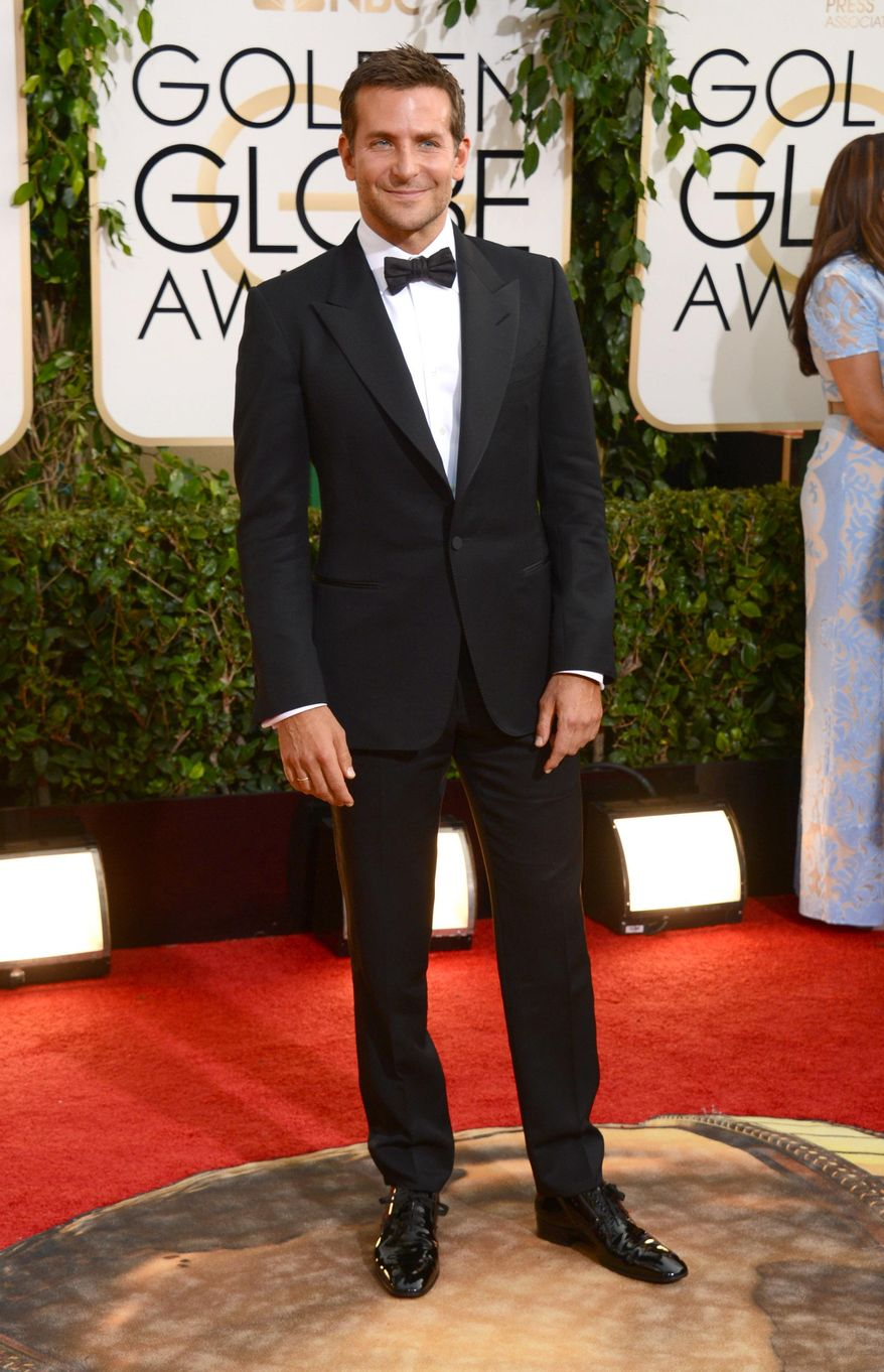 Bradley Cooper arrives at the 71st annual Golden Globe Awards at the Beverly Hilton Hotel on Sunday, Jan. 12, 2014, in Beverly Hills, Calif. (Photo by Jordan Strauss/Invision/AP)