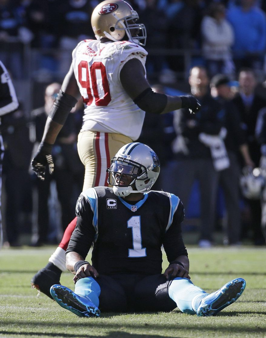 Carolina Panthers quarterback Cam Newton (1) sits on the field after being tackled against the San Francisco 49ers during the first half of a divisional playoff NFL football game, Sunday, Jan. 12, 2014, in Charlotte, N.C. (AP Photo/John Bazemore)
