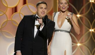 This image released by NBC shows presenters Jonah Hill, left, and Margot Robbie during the 71st annual Golden Globe Awards at the Beverly Hilton Hotel on Sunday, Jan. 12, 2014, in Beverly Hills, Calif. (AP Photo/NBC, Paul Drinkwater)