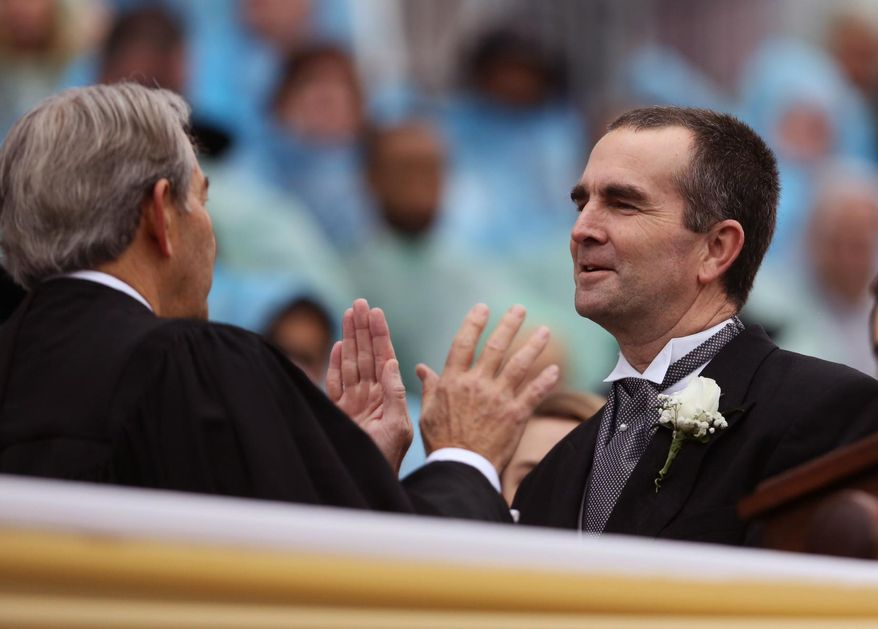 Ralph Northam is sworn is as lieutenant governor on Saturday, Jan. 11, 2014 in Richmond, Va.   (AP Photo/The Virginian-Pilot, Steve Earley)  MAGS OUT