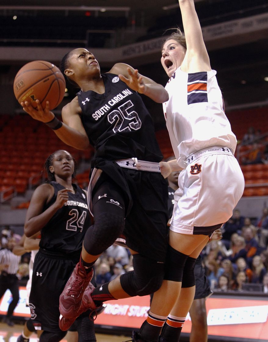 South Carolina's Tiffany Mitchell (25) goes up for a shot over Auburn's Katie Frerking (13) during the second half of an NCAA college basketball game on Sunday, Jan. 12, 2014, in Auburn, Ala. South Carolina defeated Auburn 72-66. (AP Photo/Butch Dill)