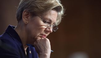 ** FILE ** In this March 7, 2013, file photo, Sen. Elizabeth Warren, D-Mass., pauses while questioning a witness at Senate Banking Committee hearing on anti-money laundering on Capitol Hill in Washington. (AP Photo/Cliff Owen, File)
