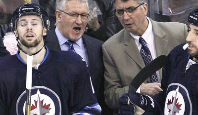 Winnipeg Jets head coach Claude Noel, right, and assistant coach Perry Pearn talk during first period NHL action against the Columbus Blue Jackets in Winnipeg, Manitoba, on Saturday, Jan. 11, 2014. Noel is out as coach of the Jets, replaced by Paul Maurice. Pearn was also fired.(AP Photo/The Canadian Press, John Woods)