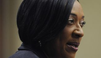 ** FILE ** In this Dec. 20, 2013, photo, Dr. Gwendolyn Boyd is offered the presidency of Alabama State University by the Board of Trustees at the ASU campus in Montgomery, Ala. Boyd is one of several women who are shattering the glass ceiling in the Montgomery area. (AP Photo/The Montgomery Advertiser, Mickey Welsh)