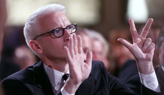 Anderson Cooper is seen bidding during the auction at the 3rd Annual Sean Penn & Friends HELP HAITI HOME Gala on Saturday, Jan. 11, 2014 at the Montage Hotel in Beverly Hills, Calif. (Photo by Colin Young-Wolff /Invision/AP)