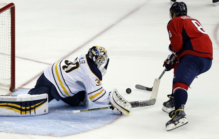 Buffalo Sabres goalie Ryan Miller (30) stops a shot by Washington Capitals right wing Alex Ovechkin (8), from Russia, in the shootout portion of an NHL hockey game, Sunday, Jan. 12, 2014, in Washington. The Sabres won 2-1. (AP Photo/Alex Brandon)