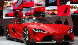 The Toyota FT-1 concept is unveiled during media previews during the North American International Auto Show in Detroit, Monday, Jan. 13, 2014. (AP Photo/Paul Sancya)