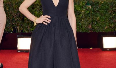 Julianna Margulies arrives at the 71st annual Golden Globe Awards at the Beverly Hilton Hotel on Sunday, Jan. 12, 2014, in Beverly Hills, Calif. (Photo by John Shearer/Invision/AP)