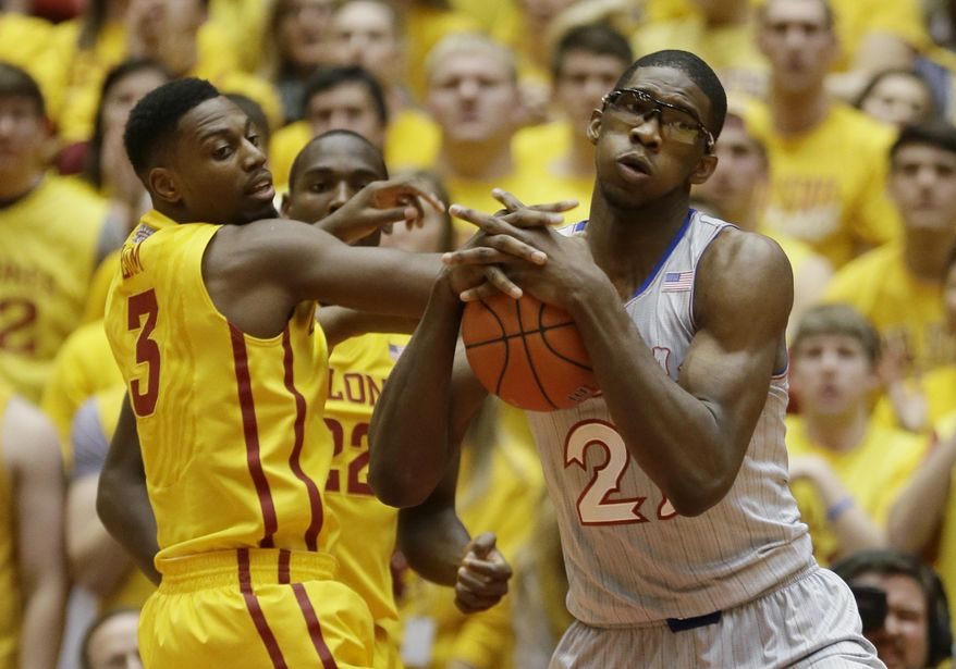 Kansas center Joel Embiid, right, fights for a rebound with Iowa State forward Melvin Ejim, left, during the first half of an NCAA college basketball game, Monday, Jan. 13, 2014, in Ames, Iowa. (AP Photo/Charlie Neibergall)