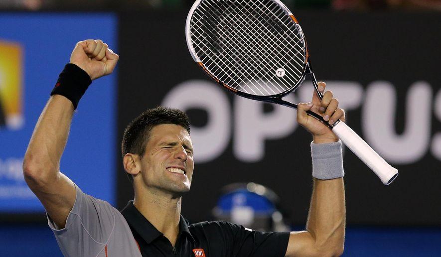 Novak Djokovic of Serbia celebrates after defeating Lukas Lacko of Slovakia in their first round match at the Australian Open tennis championship in Melbourne, Australia, Monday, Jan. 13, 2014..(AP Photo/Aaron Favila)