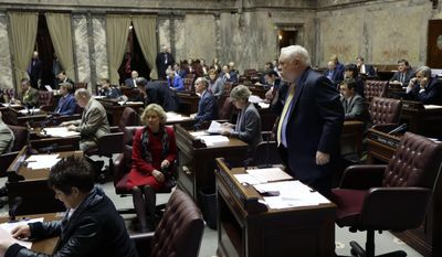 State Sen. Don Benton, R-Vancouver, right, speaks from the floor on the first day of the 2014 session of the Washington state Legislature, Monday, Jan. 13, 2014, at the Capitol in Olympia, Wash. (AP Photo/Ted S. Warren)