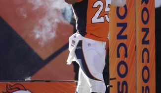 In this Jan. 12, 2014 photo Denver Broncos cornerback Chris Harris Jr. reacts to the crowd as he comes onto the field before playing against the San Diego Chargers in an NFL divisional playoff football game in Denver. A person with knowledge of the results tells The Associated Press that Harris is out for the rest of the playoffs after an MRI on Monday, jan. 13, 2014,  revealed a torn ACL in his left knee. (AP Photo/Joe Mahoney)