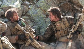 """FILE - This file photo released by Universal Pictures shows Taylor Kitsch, left, as Michael Murphy and Mark Wahlberg as Marcus Luttrell in a scene from the film, """"Lone Survivor."""" The Navy SEAL drama earned $37.8 million in its first weekend of wide release. (AP Photo/Universal Pictures, Gregory R. Peters, File)"""